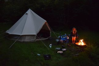 Beautiful Bell tent carried to site by happy campers
